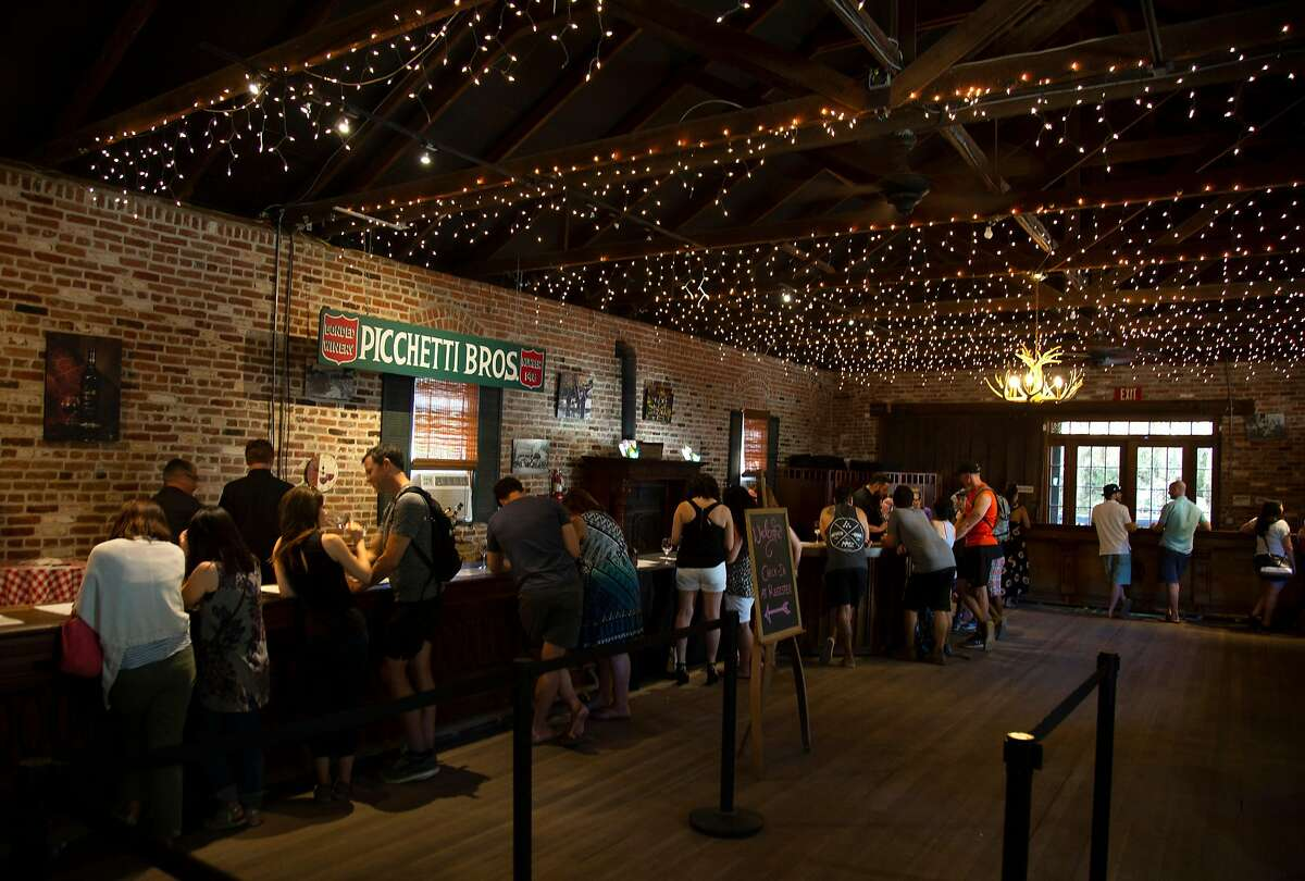Patrons try wines in the tasting room at Picchetti Winery in Cupertino, Calif. on Saturday, June 23, 2018.