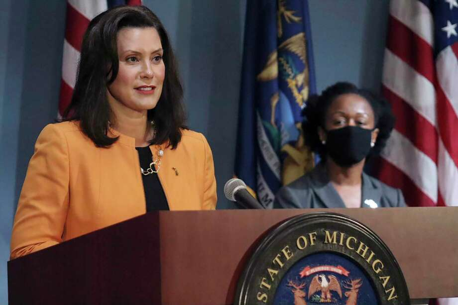 FILE - In this Aug. 19, 2020, file photo, provided by the Michigan Office of the Governor, Michigan Gov. Gretchen Whitmer addresses the state during a speech in Lansing, Mich. On Wednesday, Aug. 26, 2020, the Justice Department sent letters to the governors of Michigan and three other Democratic-led states, seeking data on whether they violated federal law by ordering public nursing homes to accept recovering COVID-19 patients from hospitals, actions that have been criticized for potentially fueling the spread of the virus (Michigan Office of the Governor via AP, File) / Michigan Office of the Governor