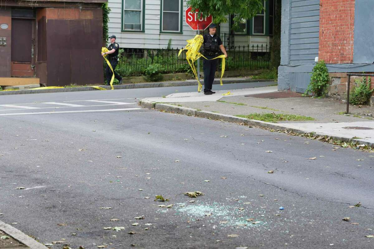 Albany Police wrap up police tape that blocked off an area or Clinton St. and Second Ave. where a shooting took place on Sunday, Aug. 30, 2020, in Albany, N.Y. (Paul Buckowski/Times Union)