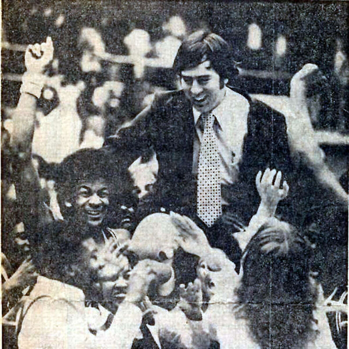 Coach Larry graham is carried off the court by Madison Trojans team and fans after winning the Vandalia Class A Sectional championship in 1977 on their way to the Class A state championship. Graham, who went on to lead Madison to another state title before moving to SIUE to become the Cougars' winningest coach, died Monday at the age of 77.
