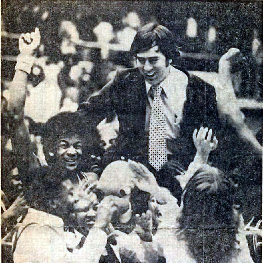 Coach Larry graham is carried off the court by Madison Trojans team and fans after winning the Vandalia Class A Sectional championship in 1977 on their way to the Class A state championship. Graham, who went on to lead Madison to another state title before moving to SIUE to become the Cougars' winningest coach, died Monday at the age of 77. Photo: File Photo