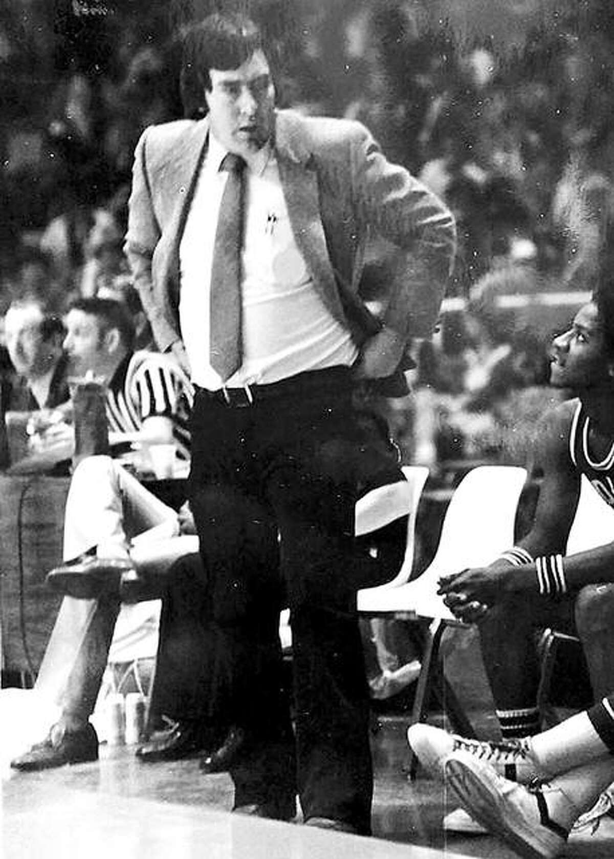 Larry Graham looks down at his bench during the 1981 IHSA Class A State Tournament at Assembly Hall in Champaign.