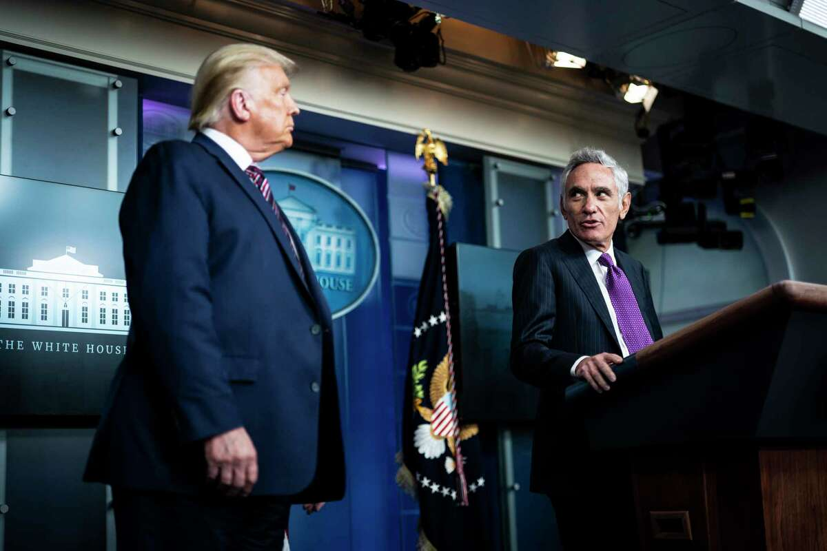 Scott Atlas, senior fellow at the Hoover Institution, speaks with President Trump during a coronavirus briefing on Aug 12, 2020.