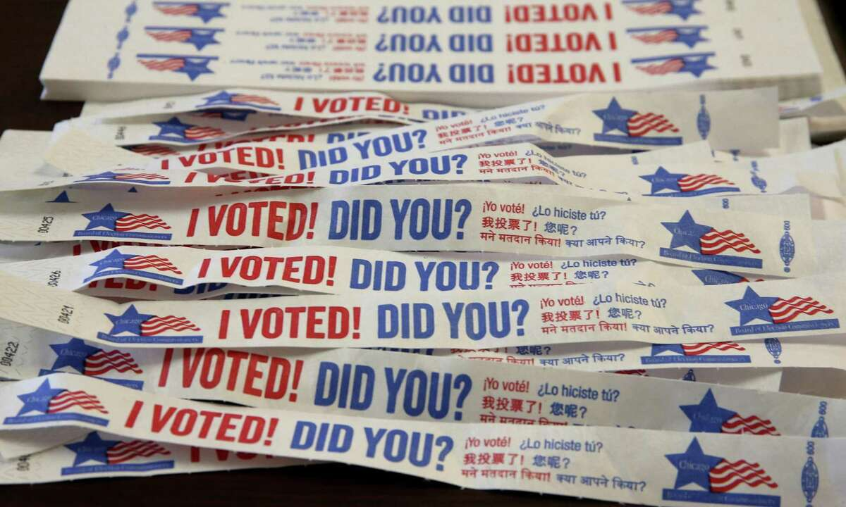 Voting tags on display as Chicago voters hit the polls on April 2, 2019. U.S. officials said they see little evidence of coordinated voter fraud or efforts by foreign adversaries to manipulate mail-in balloting ahead of the November election.