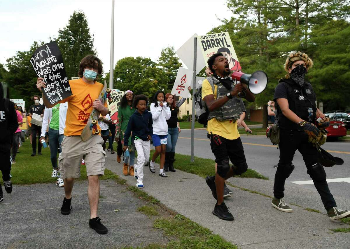 All Of Us organizer Lexis Figuereo, second from right, leads protesters in a march to city hall at a vigil Monday, Aug. 31, 2020, to mark the seventh anniversary of the police foot chase that led to the death of the 21 year-old black man in Saratoga Springs, N.Y. (Jenn March, Special to the Times Union)