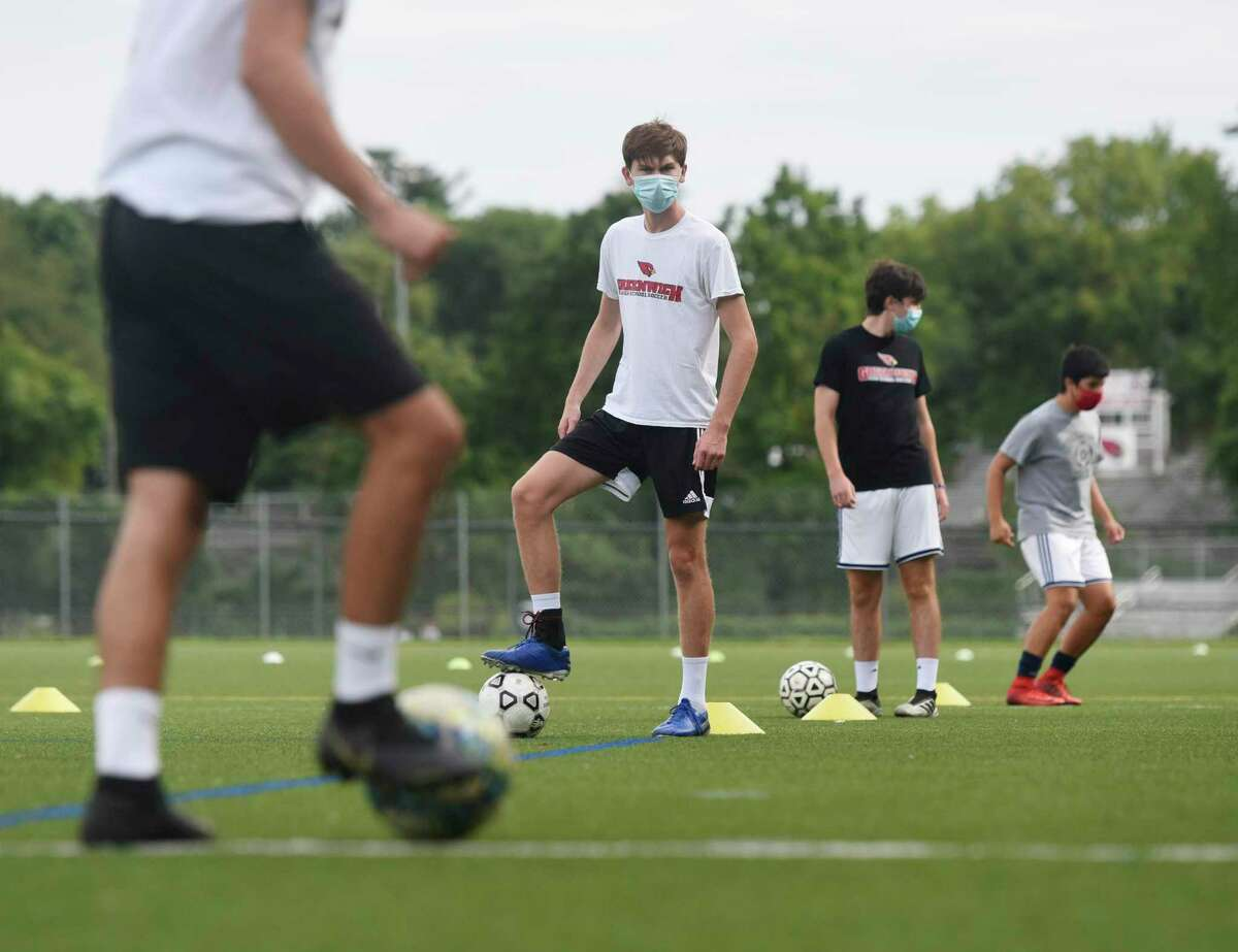 Senior Will Flynn and other players run drills during boys soccer practice at Greenwich High School in Greenwich, Conn. Monday, Aug. 31, 2020. Monday marked the official day of practice for Greenwich High School fall sports teams.