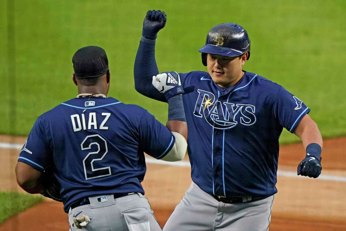 Tampa Bay Rays' Ji-Man Choi, right, celebrates with Yandy Diaz (2) after hitting a two-run home run off New York Yankees starting pitcher Gerrit Cole during the first inning of a baseball game, Monday, Aug. 31, 2020, at Yankee Stadium in New York. (AP Photo/Kathy Willens)