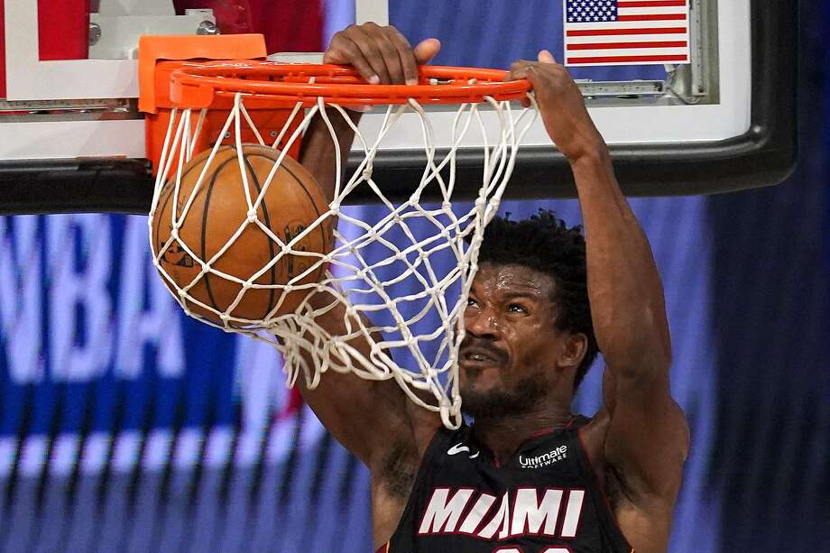 Miami Heat's Jimmy Butler dunks the ball during the second half of an NBA basketball conference semifinal playoff game against the Milwaukee Bucks on Monday, Aug. 31, 2020, in Lake Buena Vista, Fla. (AP Photo/Mark J. Terrill) Photo: Mark J. Terrill, Associated Press