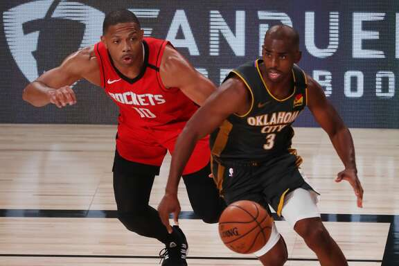 LAKE BUENA VISTA, FLORIDA - AUGUST 31: Eric Gordon #10 of the Houston Rockets defends as Chris Paul #3 of the Oklahoma City Thunder drives the ball during the third quarter in Game Six of the Western Conference First Round during the 2020 NBA Playoffs at AdventHealth Arena at ESPN Wide World Of Sports Complex on August 31, 2020 in Lake Buena Vista, Florida. NOTE TO USER: User expressly acknowledges and agrees that, by downloading and or using this photograph, User is consenting to the terms and conditions of the Getty Images License Agreement. (Photo by Mike Ehrmann/Getty Images)