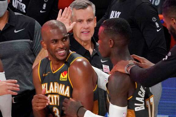 Chris Paul, left, coach Billy Donovan, center, and Dennis Schroder rejoice that the Thunder get to stay in Florida for at least two more days.