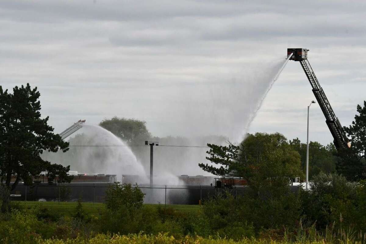 Firefighters deal with a leak from a tanker car Tuesday morning at the Sabic company's facility along Route 32 in the Selkirk section of Bethlehem.