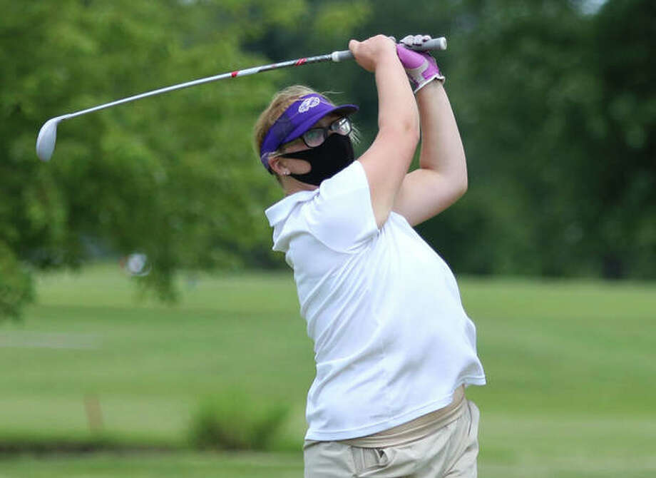 CM's Peyton Mormino watches her shot during the Madison County Tournament on Aug. 18 at The Legacy golf course in Granite City. On Monday, Mormino's 47 was best for the Eagles in a quadrangular at Highland Country Club. Photo: Greg Shashack / The Telegraph