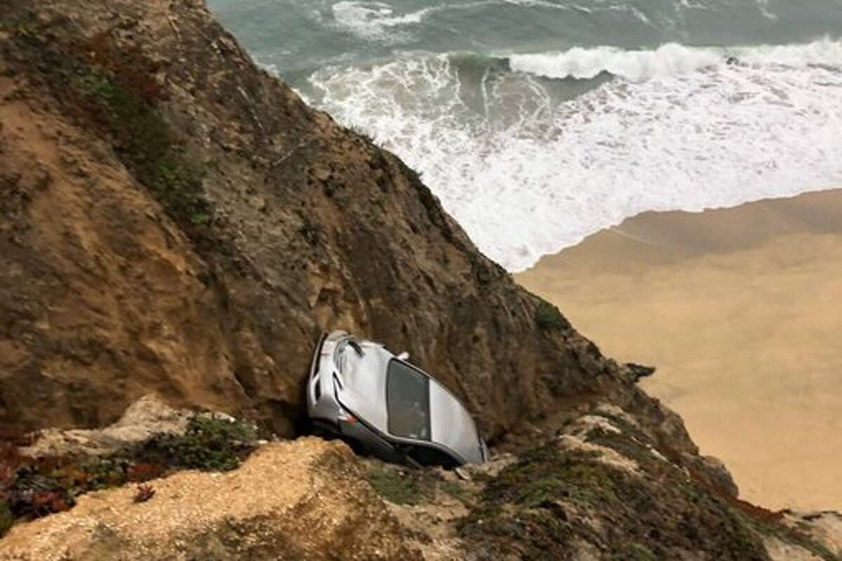 Cal Fire firefighters were at the scene of a vehicle over the cliff off of Highway 1 near Gray Whale Cove south of Devils Slide in San Mateo County on Aug. 31, 2020.