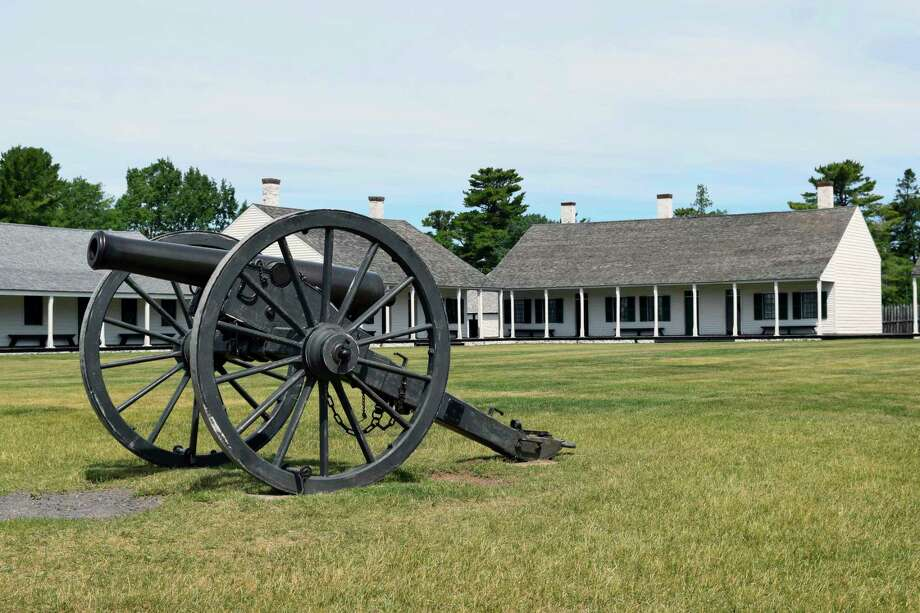 A cannon sits on the Fort Wilkins Historic State Park parade grounds. The 1840's post hospital, east barracks and mess hall are visible in the background. (Courtesy photo/Michigan Department of Natural Resources)