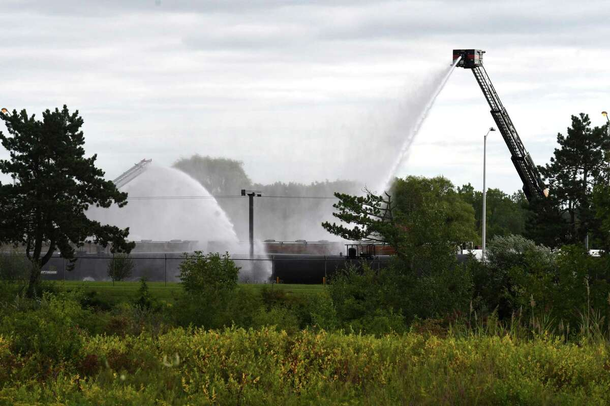 Rail tanker cars at the Sabic plant on Creble Road and Route 32 are sprayed with water after a tanker began to vent its contents into the atmosphere on Tuesday, Sept. 1, 2020, in Bethlehem, N.Y. (Will Waldron/Times Union)
