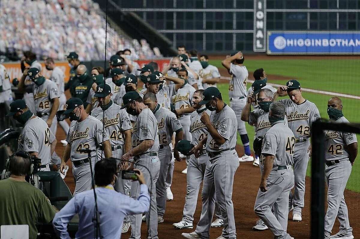 HOUSTON, TEXAS - AUGUST 28: The Oakland Athletics walk off the field before playing the Houston Astros as both teams elected not to play in protest of racial injustice and the shooting of Jacob Blake by Kenosha, Wisconsin police at Minute Maid Park on August 28, 2020 in Houston, Texas. All players are wearing #42 in honor of Jackie Robinson Day. The day honoring Jackie Robinson, traditionally held on April 15, was rescheduled due to the COVID-19 pandemic. (Photo by Bob Levey/Getty Images)