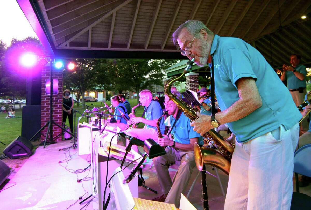 The Little Big Band's John Christie performs a solo in Glenn Miller's song In The Mood during Shelton's Summer Concert series at Riverview Park on Wednesday.