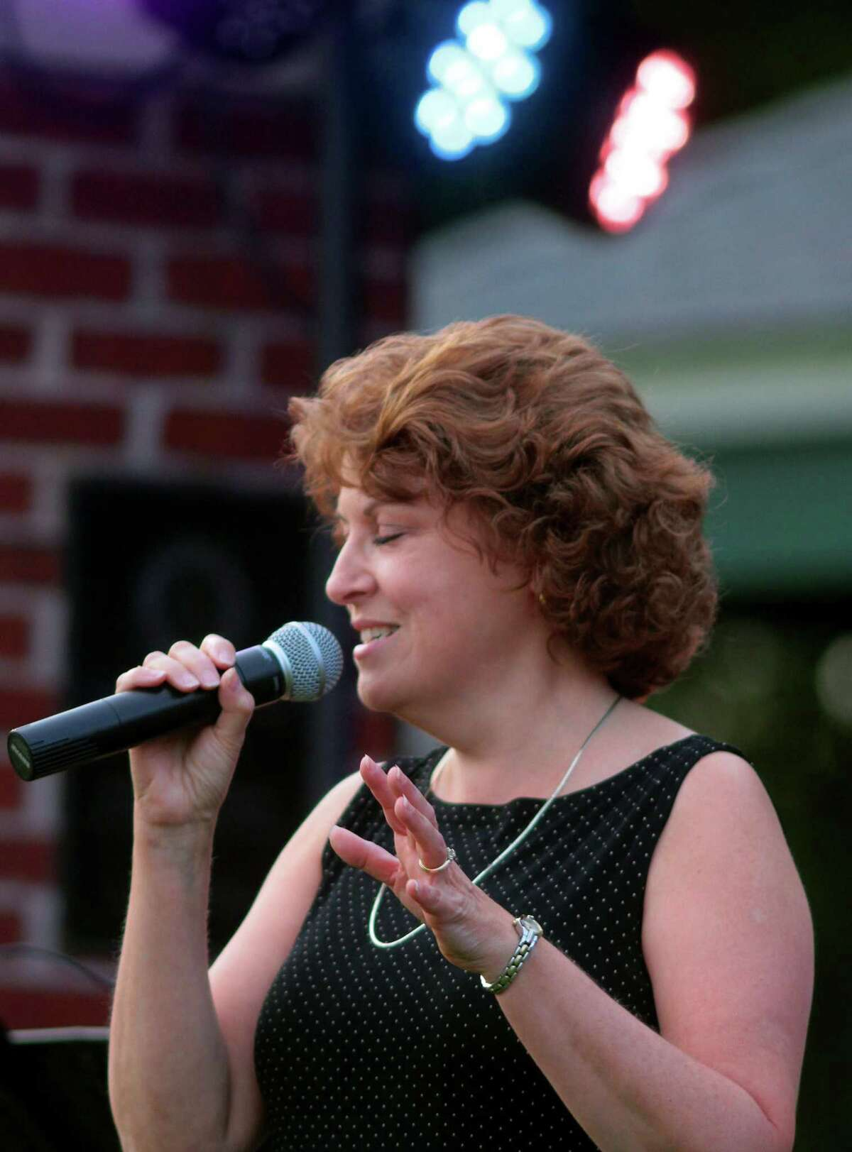 The Little Big Band's Joyce Medling performs during Shelton's Summer Concert series at Riverview Park in Shelton, Conn., on Wednesday Aug.26, 2020.