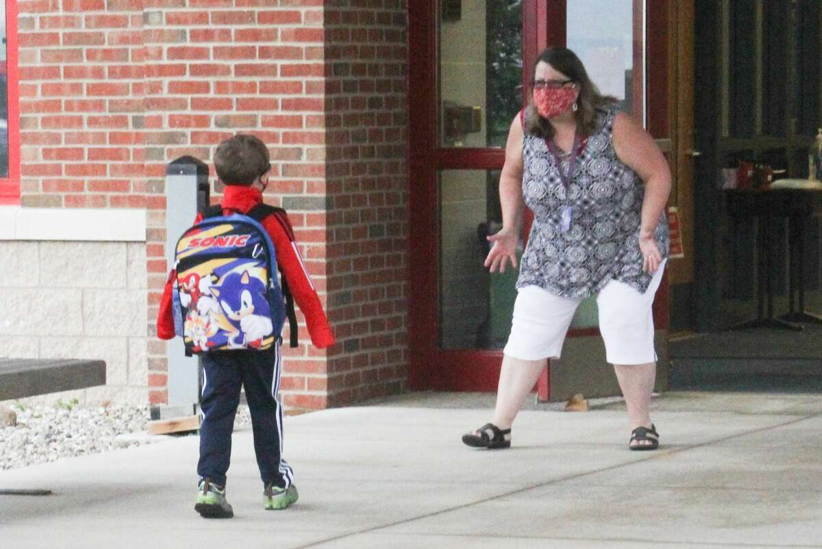Students at Unionville-Sebewaing Area Elementary School arrive on the first day of classes Tuesday morning. It was the first time since March that students attended in-person classes after schools were closed due to the coronavirus pandemic.