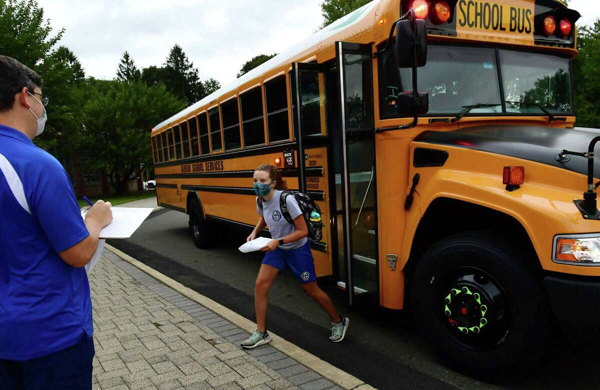 All Saints Catholic School students arrive for their first day of class, Tuesday, September 1, 2020, in Norwalk, Conn. The school staggered its opening this year with grades six through eight attending Tuesday.