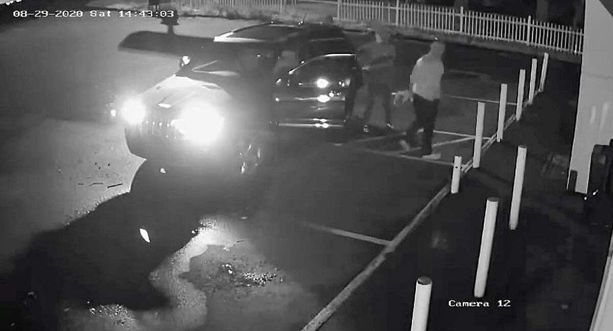 A screenshot of surveillance footage from a Naugatuck, Conn., store showing three male suspects that police said tried to break in to the business.