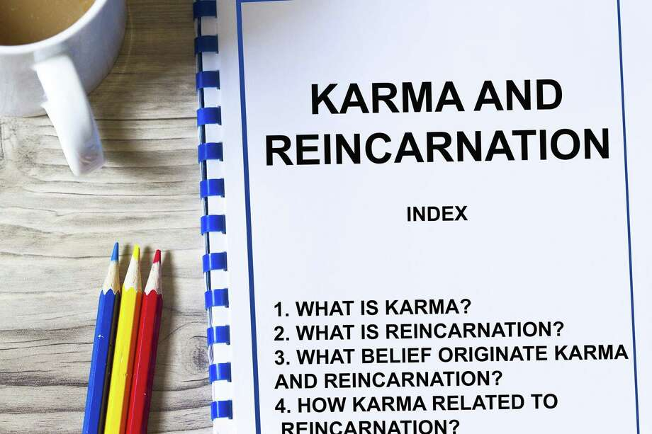 Karma and Reincarnation concept, with topics on a cover sheet of a lecture. Photo: Dreamstime / (c) Ragsac19 | Dreamstime.com