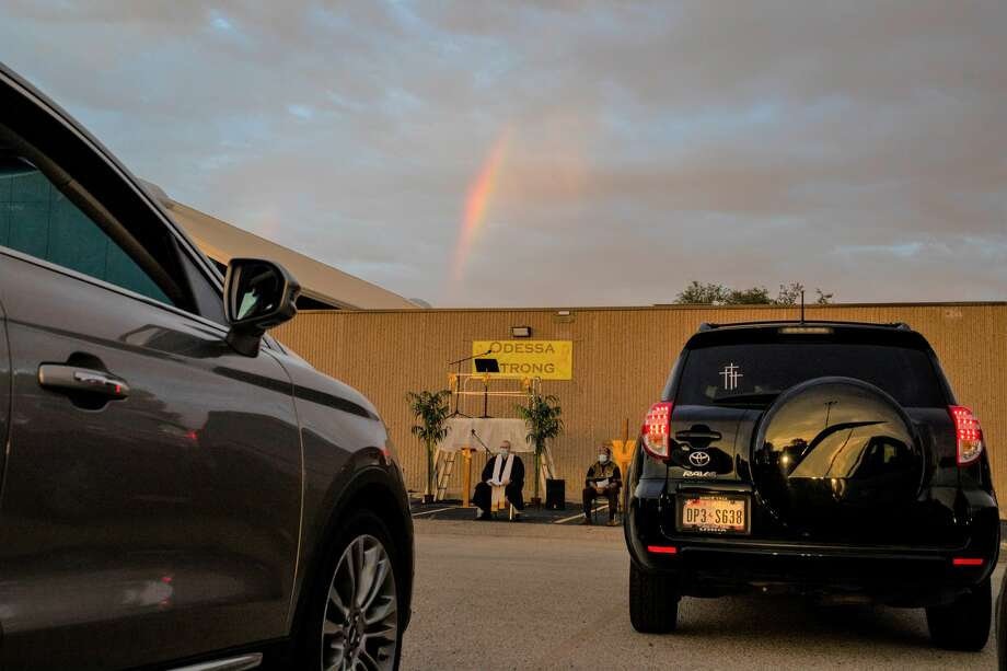 A rainbow shines over the drive-in prayer service Monday, Aug. 31, 2020 at Connection Christian Church in Odessa. Photo: Jacy Lewis/Reporter-Telegram / MRT