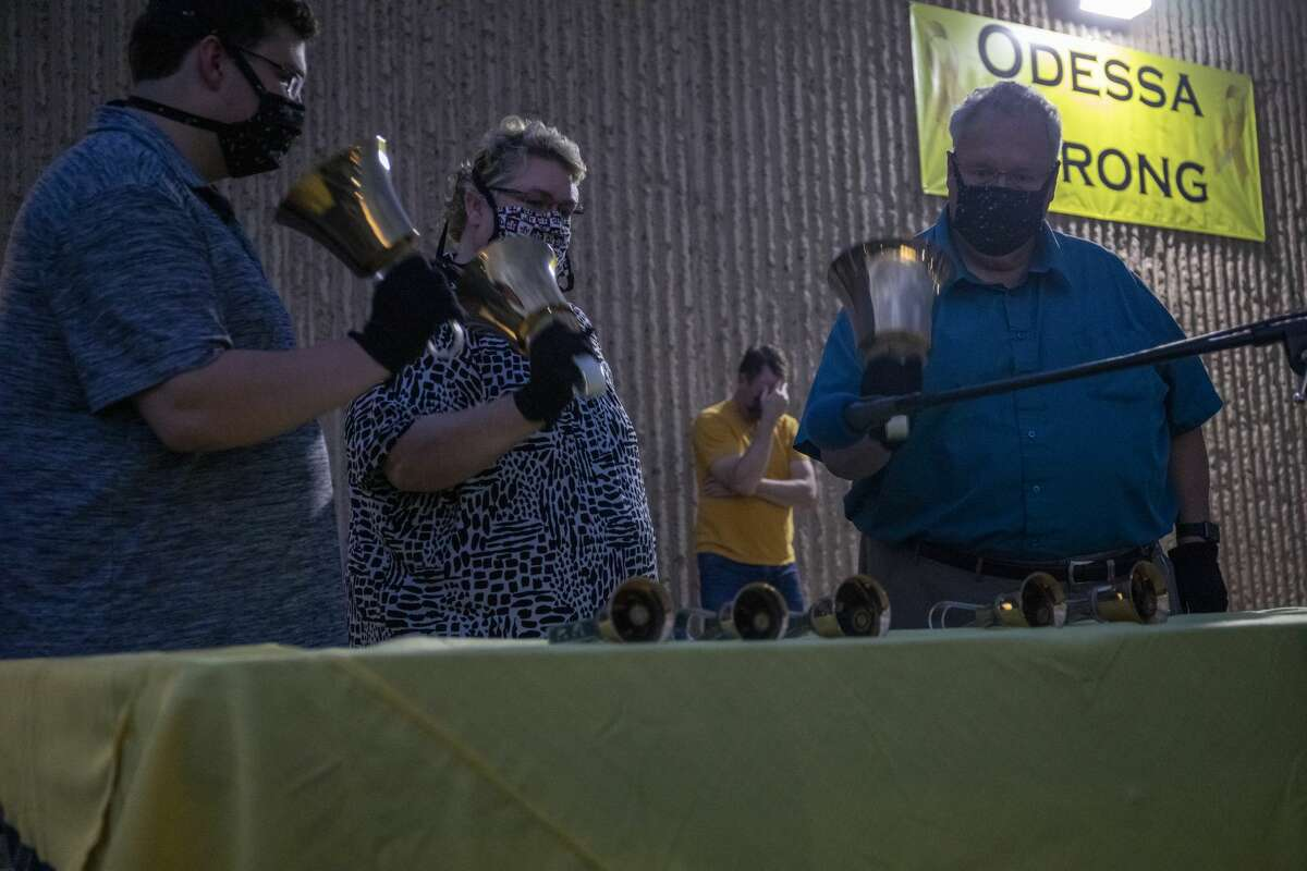 Bell ringers play the bells for victims of the mass shooting Monday, Aug. 31, 2020 at Connection Christian Church in Odessa.