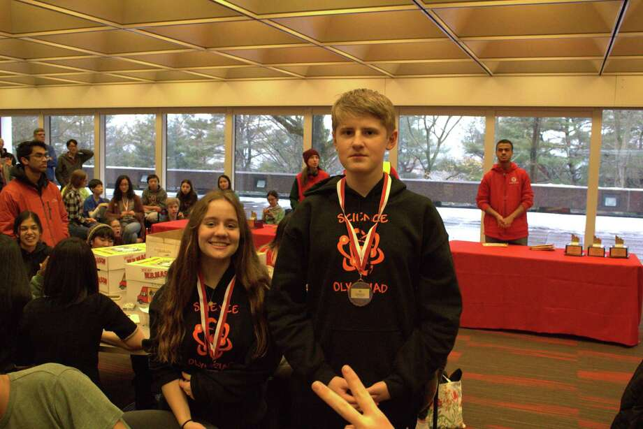 Alena Alexander and Ian Murdock win 3rd place medals in Anatomy & Physiology at the Sacred Heart Invitational. Photo: Contributed / RHS Science Olympiads