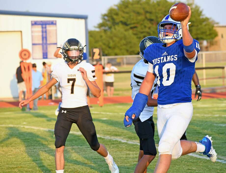 Olton's Jack Allcorn celebrates a touchdown run during the Mustangs' 37-27 loss to Sudan in their season opening high school football game on Friday, Aug. 28, 2020 at Olton. Photo: Nathan Giese/Planview Herald