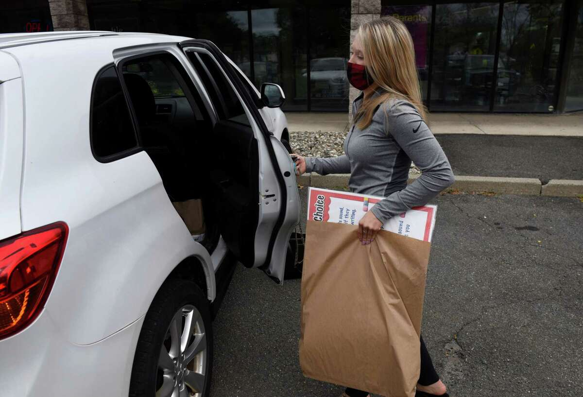 Haley Jansen, a fourth grade teacher at St. Madeleine Sophie School, picks up classroom material from a local school supply store on Tuesday, Sept. 1, 2020, in Colonie, N.Y. (Will Waldron/Times Union)