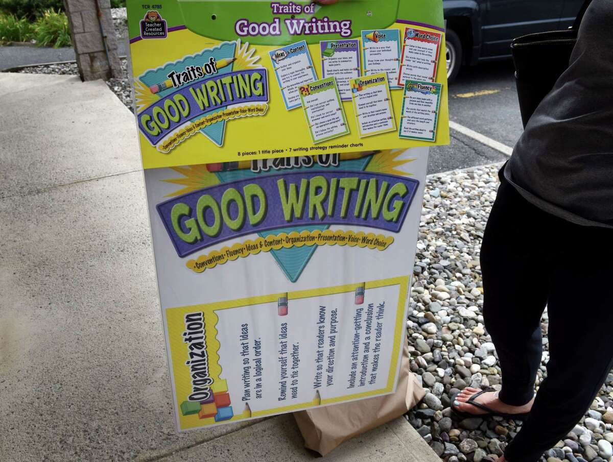 Haley Jansen, a fourth grade teacher at St. Madeleine Sophie School, displays classroom material she purchased from a local school supply store on Tuesday, Sept. 1, 2020, in Colonie, N.Y. (Will Waldron/Times Union)