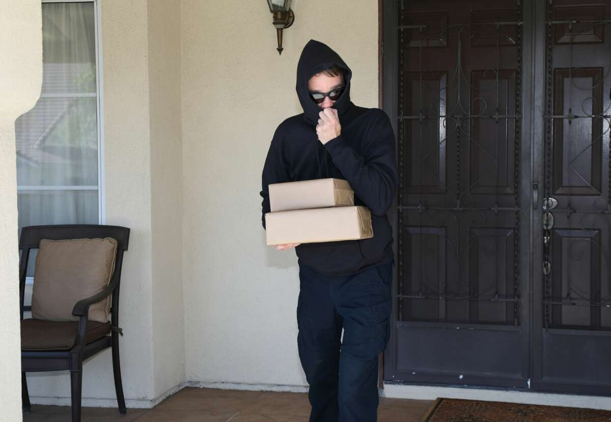 Porch pirate steals packages.