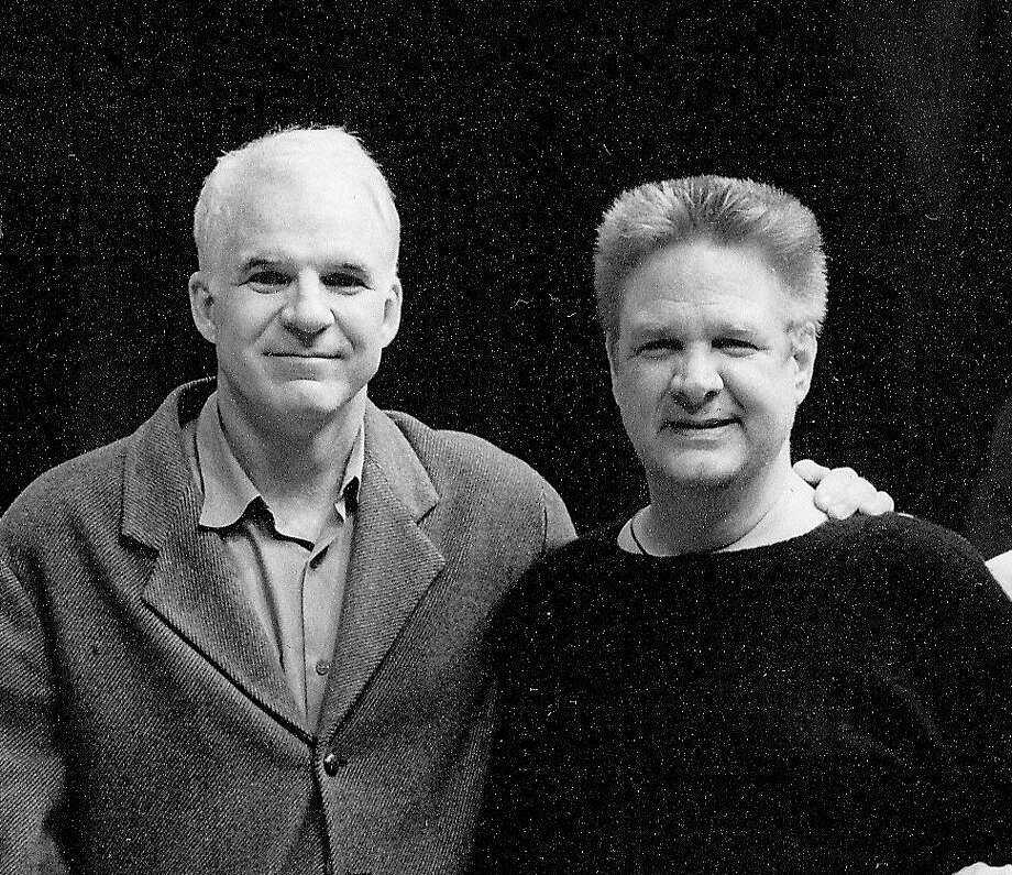 """Steve Martin (left) and Albert Poland (right) pose for a photograph during rehearsals for Martin's play """"Picasso at the Lapin Agile."""" Poland was the show's general manager. (Courtesy photo)"""