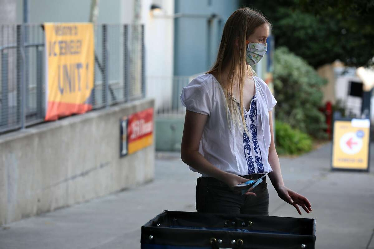 Student Cameron Johnson, 19 years old, begins to move to her dorm room on Thursday, Aug. 20, 2020, in Berkeley, Calif. Some of the 2,200 students who will be on the UC Berkeley campus began moving into Units 1 and Units 2.