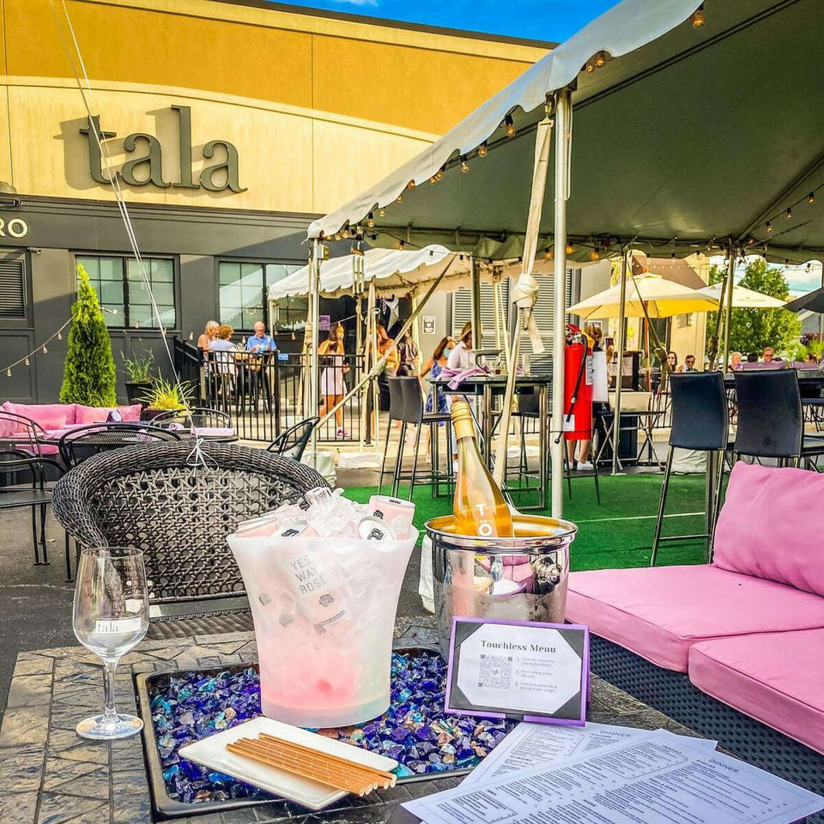 Outdoor seating at Tala - An American Bistro in Latham includes tables on the patio and under a tent. (Provided photo.)