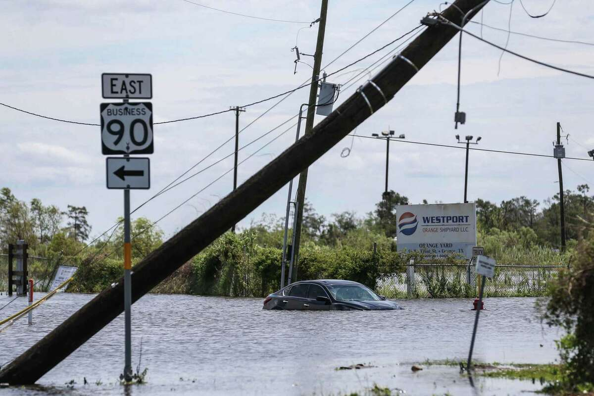 A car submerged in a flood on Pier Rd after Hurricane Laura hit the area overnight in Orange on Thursday, August 27, 2020. After Hurricane Laura made landfall on the Texas Coast last week, the flow of the Neches River slowed and then reversed entirely. (Lola Gomez/Austin American-Statemen/TNS)