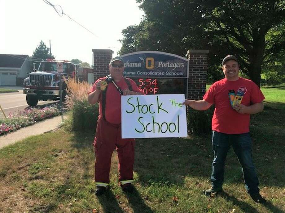 "The Onekama Fire Department joined in to lend a hand at the ""Stock the School"" fundraiser put on by the Onekama Athletic Boosters and Parent Teacher Organization on Thursday. (Courtesy photo)"