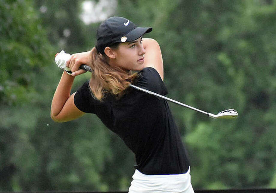 Edwardsville sophomore Nicole Johnson watches her iron shot during first-round action of the Southwestern Conference Tournament on Tuesday at Belk Park Golf Course in Wood River. Photo: Matt Kamp|The Intelligencer