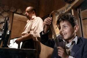 """Salvatore Cascio, left, and Philippe Noiret in """"Cinema Paradiso."""" (Miramax)"""