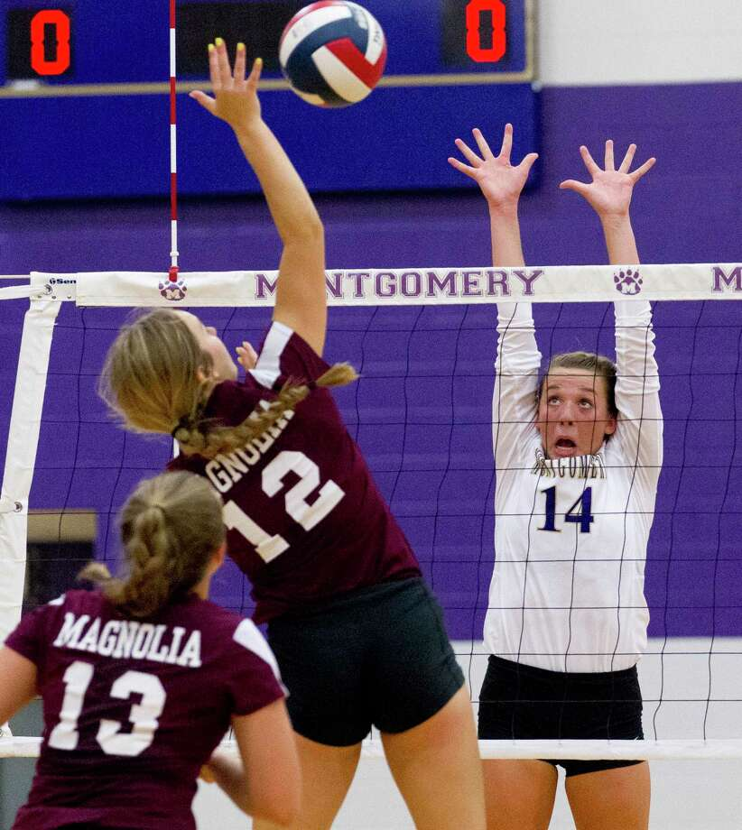 Raina McWhirter #14 of Montgomery looks to block a shot by Sydney Gentry #12 of Magnolia during the second set of a non-district high school volleyball match at Montgomery High School, Tuesday, Aug. 6, 2019, in Montgomery. Photo: Jason Fochtman, Houston Chronicle / Staff Photographer / Houston Chronicle