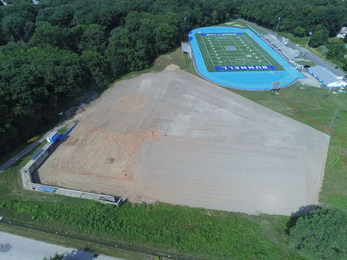 An aerial view of the athletic complex at Bunnell High School in Stratford. The baseball field, which will include a new multi-purpose field in the outfield, is in the foreground under construction, with Robert Mastroni Field in the background.