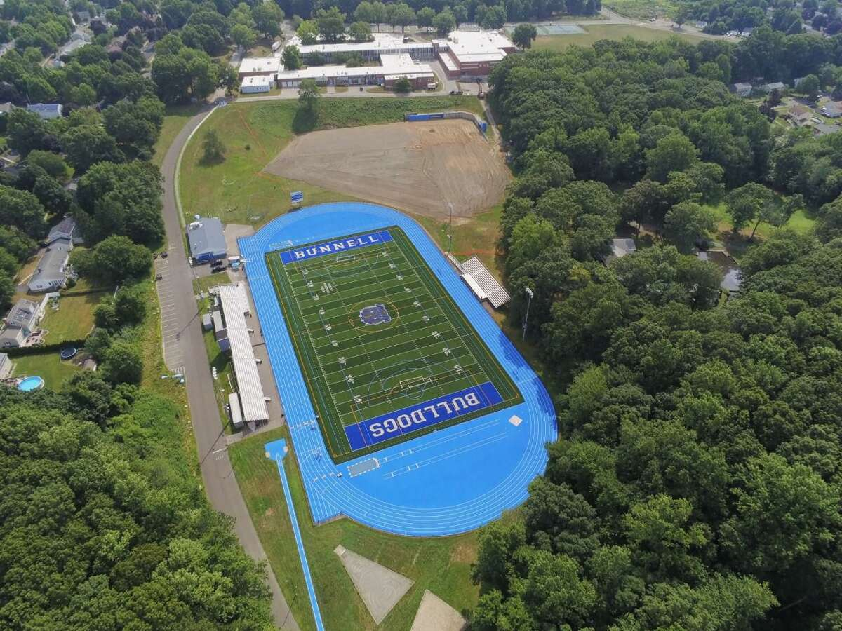 An aerial view of the refurbished athletic complex at Bunnell High School in Stratford. Robert Mastroni Field and the track are in the foreground, and the site of a new baseball field and multi-purpose field are in the background.