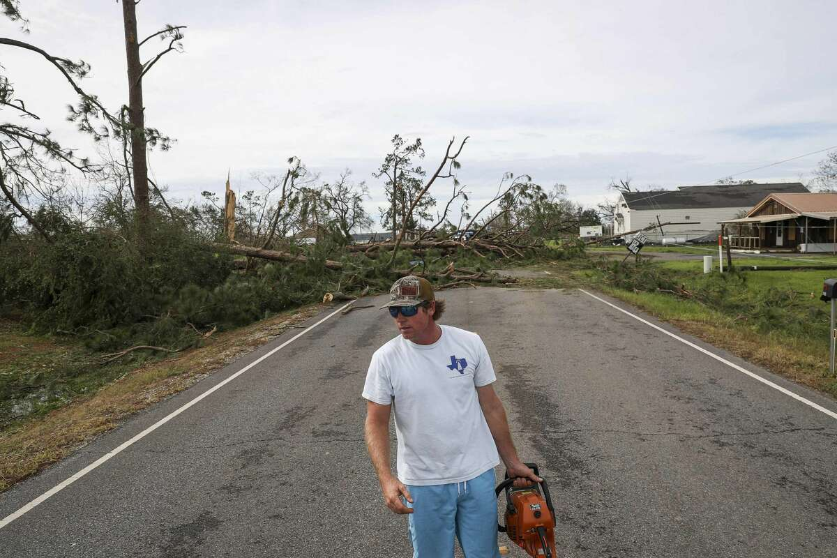 Jeff Steckler prepares to saw a tree that is blocking a road the morning after Hurricane Laura moved through the area Aug. 27, 2020, in Grand Lake.