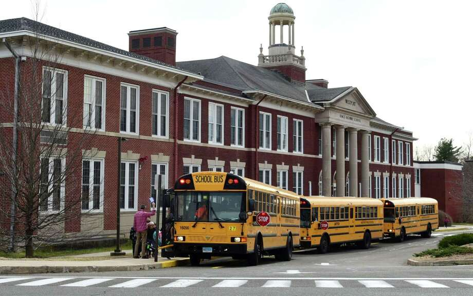 Students leave Kings Highway Elementary School on the announcement that Westport Schools will be closed for the unforeseen future Wednesday, March 11, 2020, in response to the Covid-19 virus pandemic in Westport, Conn. Photo: Erik Trautmann / Hearst Connecticut Media / Norwalk Hour
