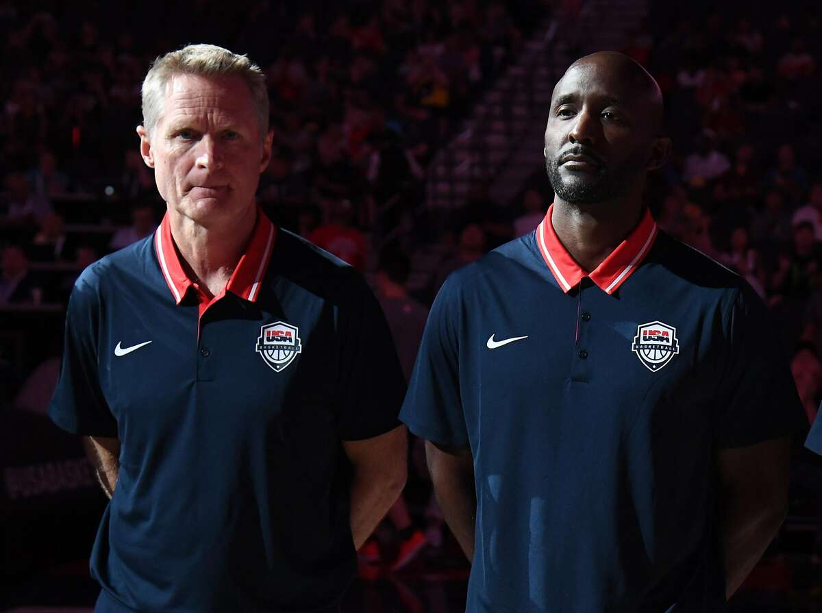 LAS VEGAS, NEVADA - AUGUST 09: Assistant coaches Steve Kerr (L) and Lloyd Pierce of the 2019 USA Men's National Team are introduced before the 2019 USA Basketball Men's National Team Blue-White exhibition game at T-Mobile Arena on August 9, 2019 in Las V