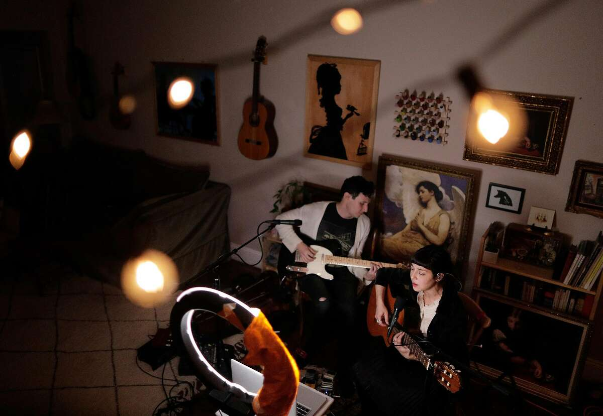 Laura Weinbach and Anton Patzner, known as Foxtails Brigade, hold a streaming show on Mondays at 7:30 in their home in Oakland, Calif., on Monday, April 6, 2020. The couple has been holding these shows for years.