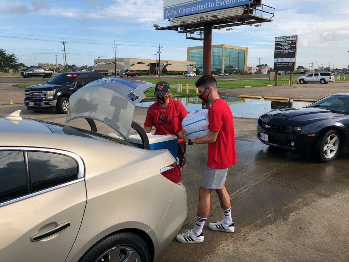 Lamar athletes and coaches helped load ice bags for Port Arthur residents without power after Hurricane Laura.