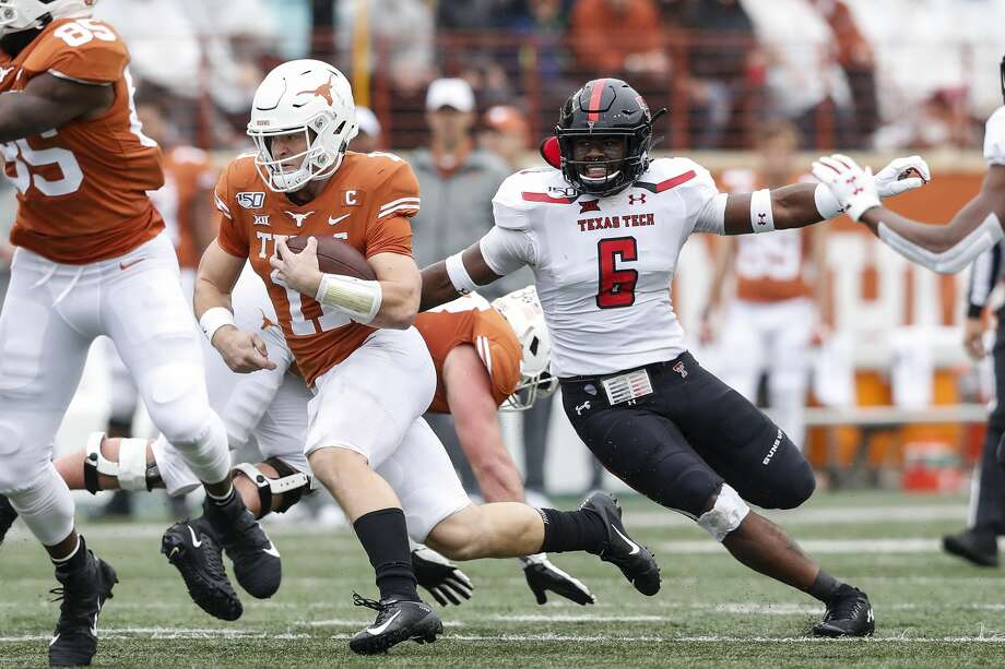 AUSTIN, TX - NOVEMBER 29: Sam Ehlinger #11 of the Texas Longhorns runs the ball defended by Riko Jeffers #6 of the Texas Tech Red Raiders in the first quarter at Darrell K Royal-Texas Memorial Stadium on November 29, 2019 in Austin, Texas. (Photo by Tim Warner/Getty Images) Photo: Tim Warner/Getty Images / 2019 Getty Images