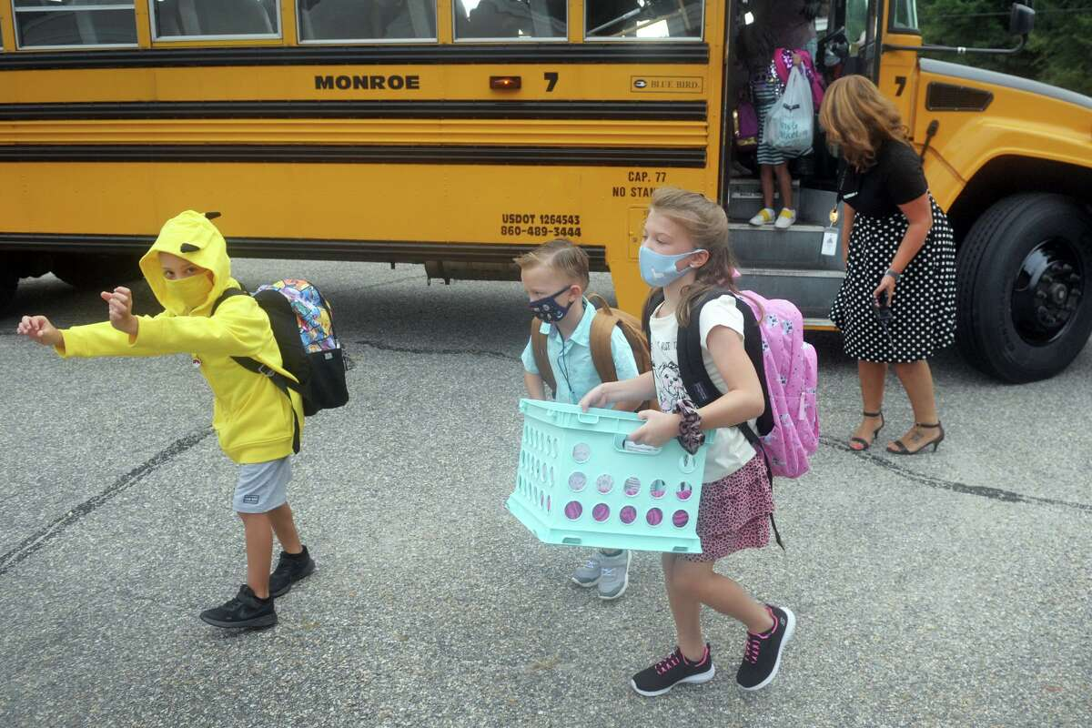 Students arrive for the first day of classes at Monroe Elementary School, in Monroe, Conn. Sept. 1, 2020.